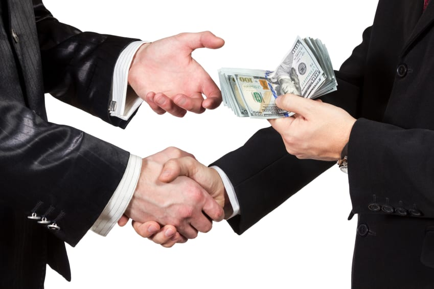 man being handed money with regard to work