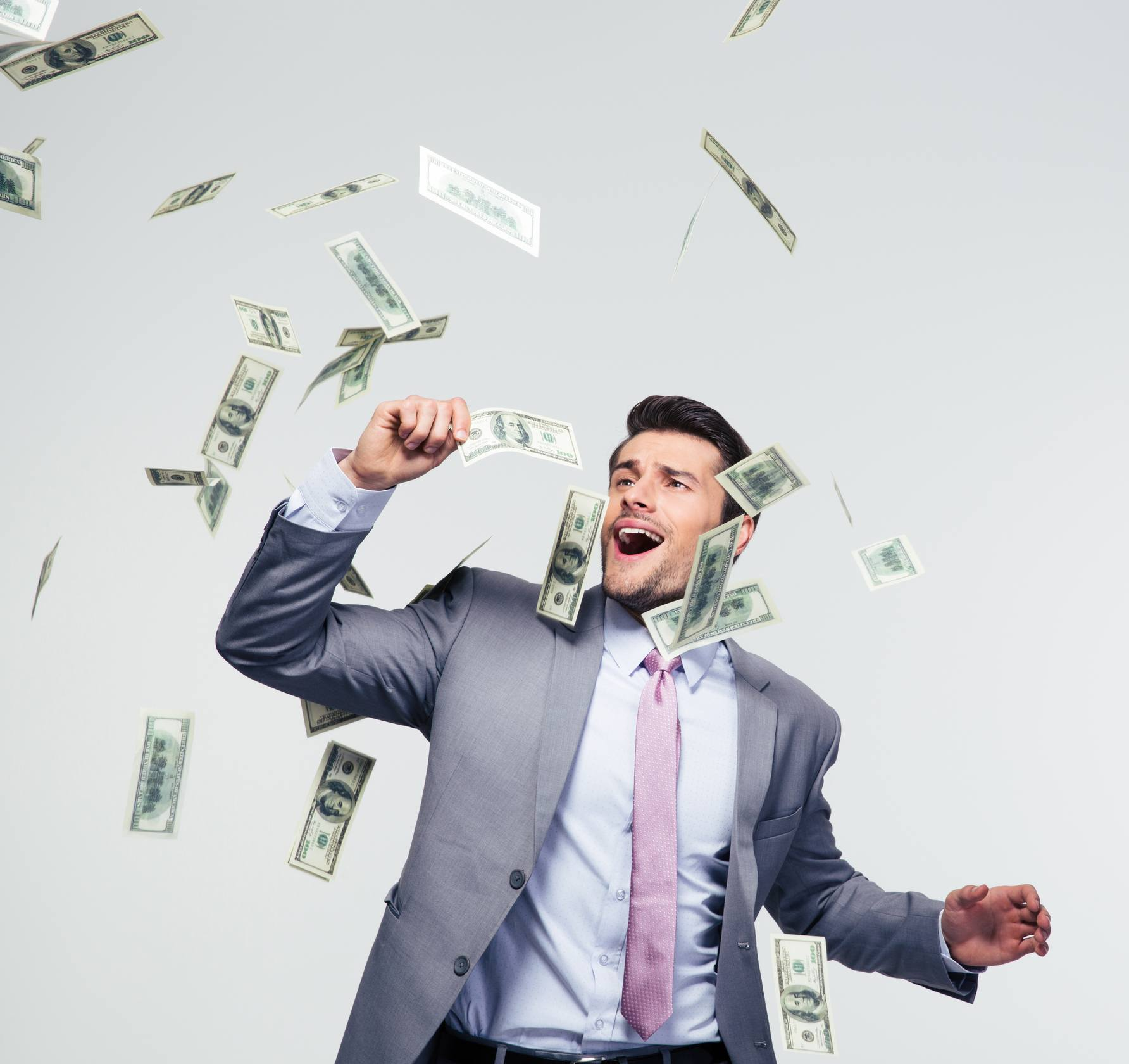 Man in suit with dropping money