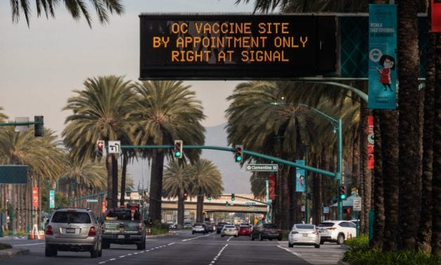 Orange colored County's Wait for Vaccine Proceeds as COVID-19 Cases Falls